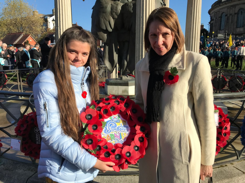 Maddi and Shelley Oliver lay a wreath at Shrewsbury's war memorial
